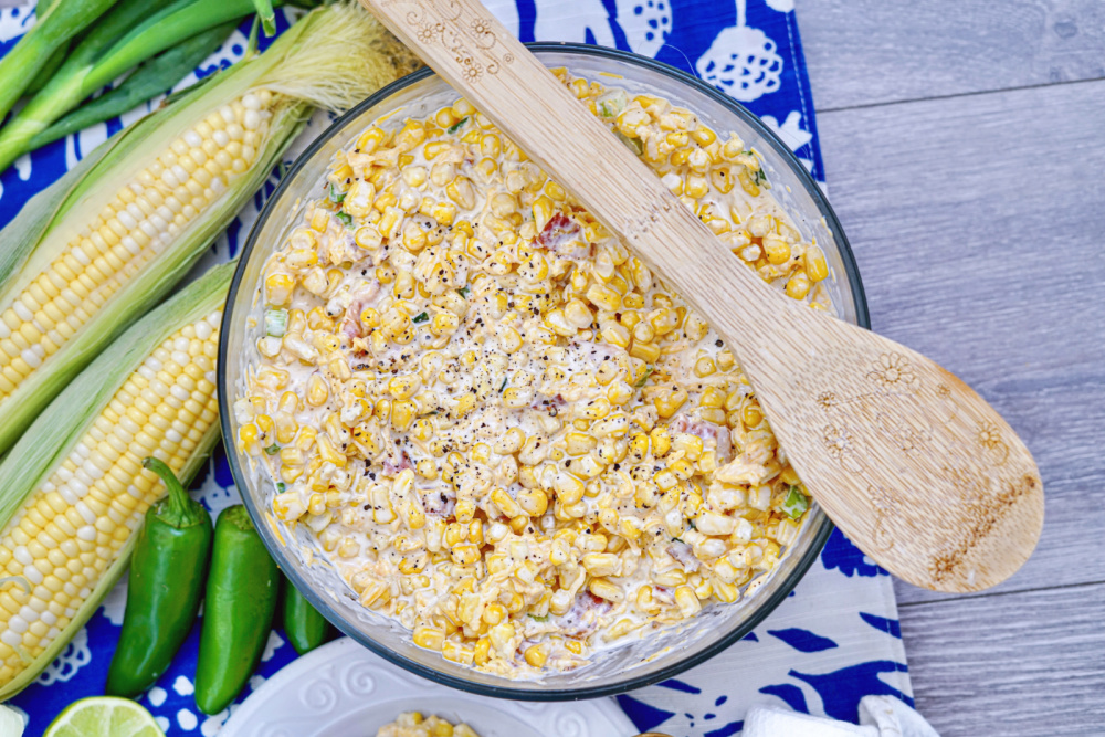 I am so excited to share this recipe for Crack Corn Salad with you! I've been making it for years and my family loves it. It is a great dish to bring to any potluck.